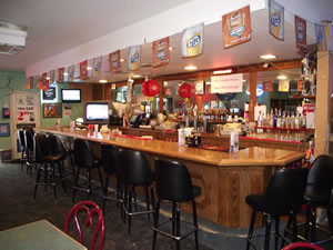 Comfortable seating at the bar or at tables.